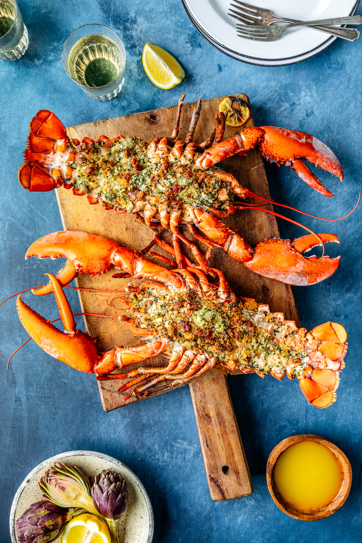 Whole Stuffed Maine Lobster with Herby Artichoke and Pancetta Bread Crumbs
